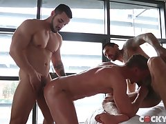 Skyy Knox eventually becomes the center of attention as the guys temporarily move from the bed to standing in the window, where Skyy finally gets nailed by Boomer Banks while Arad WinWin sucks him from the front.