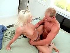 Jacque Johnson sprays cum on Brittany Amber`s big boobs.